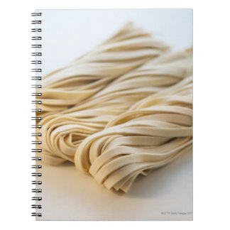 Studio shot of fresh linguini pasta notebook