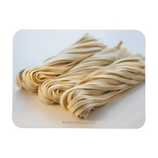 Studio shot of fresh linguini pasta rectangular photo magnet