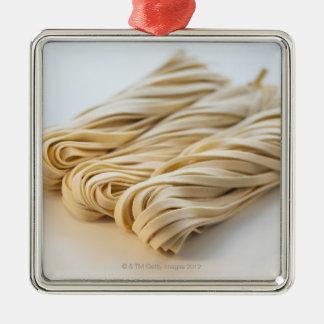Studio shot of fresh linguini pasta Silver-Colored square decoration