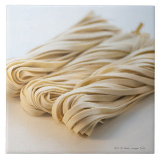 Studio shot of fresh linguini pasta tile