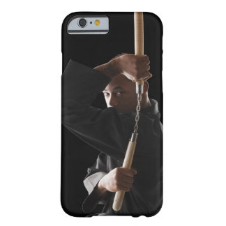 Studio shot of man exercising with nunchaku barely there iPhone 6 case