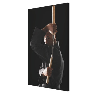 Studio shot of man exercising with nunchaku canvas print