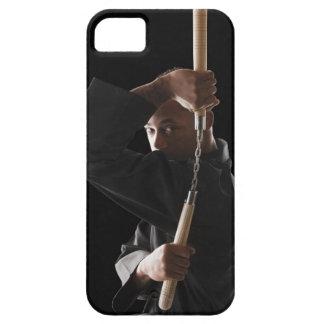 Studio shot of man exercising with nunchaku iPhone 5 case