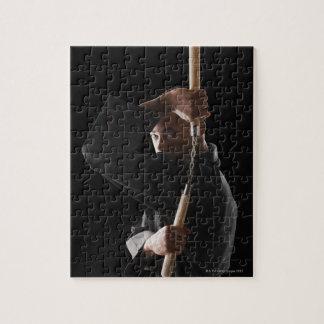 Studio shot of man exercising with nunchaku jigsaw puzzle