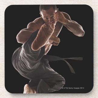 Studio shot of martial arts practitioner in coaster