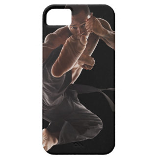 Studio shot of martial arts practitioner in iPhone 5 cover