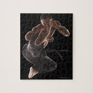 Studio shot of martial arts practitioner in jigsaw puzzle