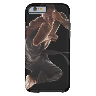 Studio shot of martial arts practitioner in tough iPhone 6 case