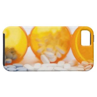 Studio shot of medicine bottle with pills iPhone 5 covers