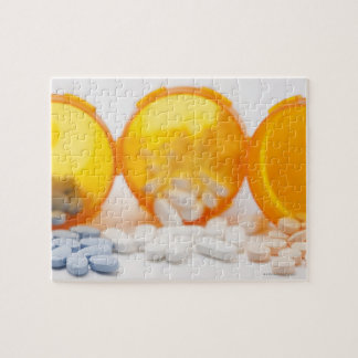 Studio shot of medicine bottle with pills jigsaw puzzle