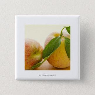 Studio shot of peaches 15 cm square badge