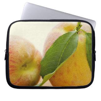 Studio shot of peaches computer sleeve