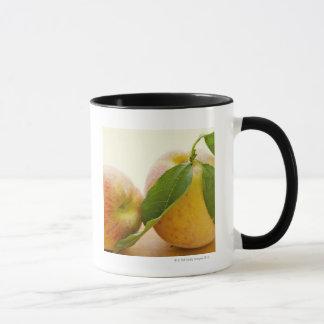 Studio shot of peaches mug