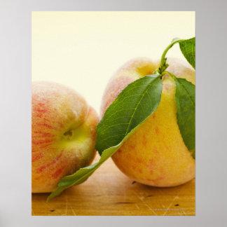 Studio shot of peaches poster