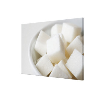 Studio shot of sugar cubes in bowl canvas print