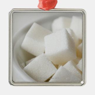 Studio shot of sugar cubes in bowl christmas tree ornaments