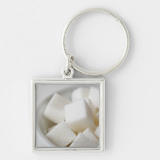 Studio shot of sugar cubes in bowl Silver-Colored square key ring