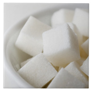 Studio shot of sugar cubes in bowl tile