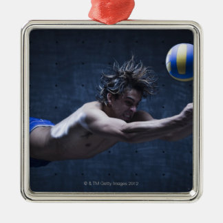 Studio shot of volleyball player playing 2 christmas ornament
