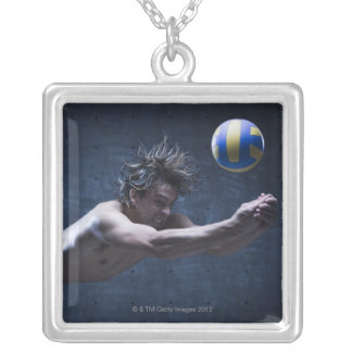 Studio shot of volleyball player playing 2 silver plated necklace
