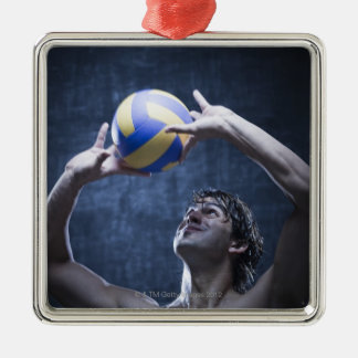 Studio shot of volleyball player playing christmas ornament
