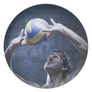 Studio shot of volleyball player playing plate