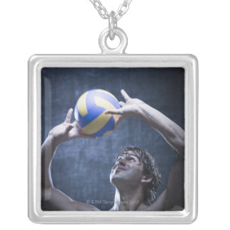 Studio shot of volleyball player playing silver plated necklace
