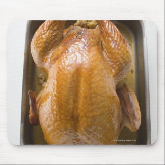 Stuffed roast turkey in roasting tray, close up mouse mat