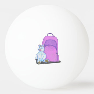 Stuffed Unicorn sits by a purple school Backpack Ping Pong Ball
