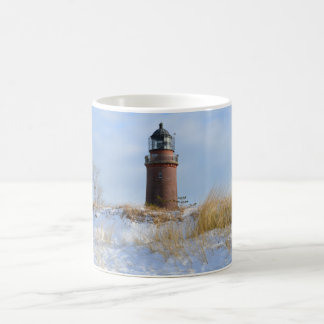 Sturdy Lighthouse on a Rocky Coast in Winter Basic White Mug