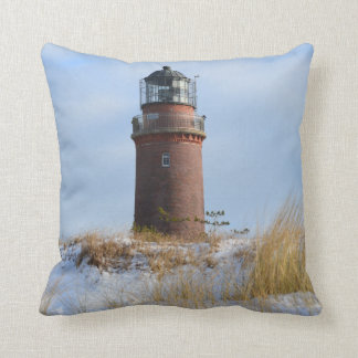 Sturdy Lighthouse on a Rocky Coast in Winter Cushions