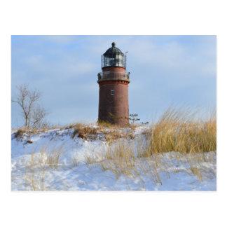 Sturdy Lighthouse on a Rocky Coast in Winter Postcard