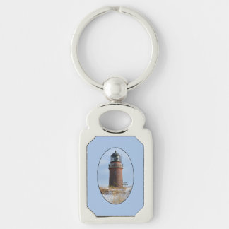 Sturdy Lighthouse on a Rocky Coast in Winter Silver-Colored Rectangle Key Ring