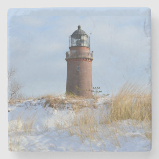 Sturdy Lighthouse on a Rocky Coast in Winter Stone Beverage Coaster