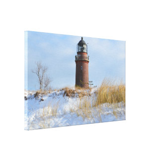 Sturdy Lighthouse on a Rocky Coast in Winter Stretched Canvas Prints