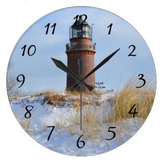 Sturdy Lighthouse on a Rocky Coast in Winter Wallclock