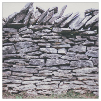 sturdy stacked stones fence fabric