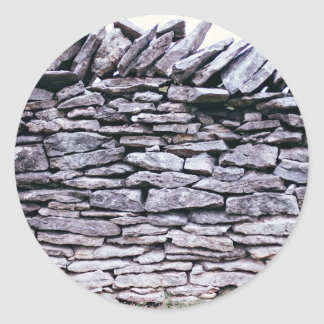 sturdy stacked stones fence round sticker