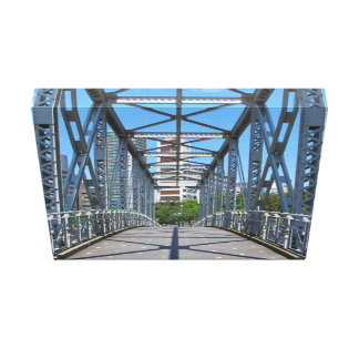 Sturdy steel bridge in city gallery wrapped canvas