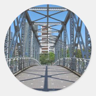 Sturdy steel bridge in city round sticker
