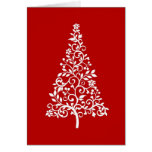 Stylised White Christmas tree on red holiday card