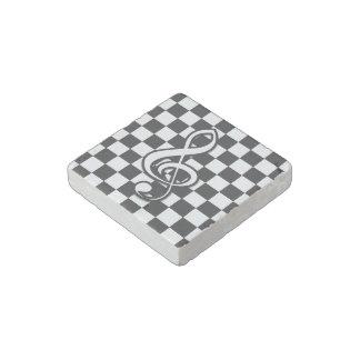 Stylish black and white music note on checks stone magnet