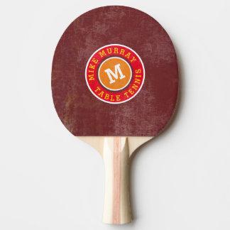 stylish circle logo monogram on red ping pong paddle