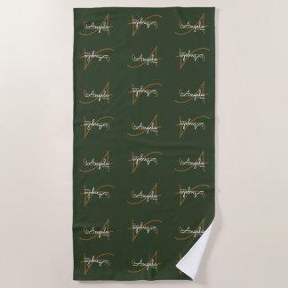 stylish monograms pattern on green beach towel