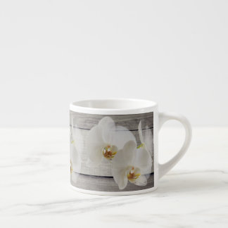 Sulk with an orchid espresso cup