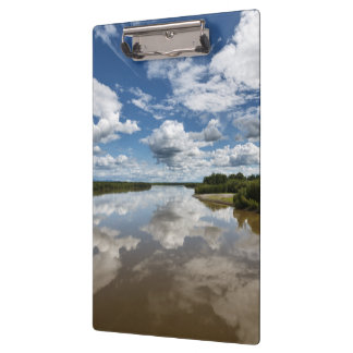 Summer landscape: clouds reflection in water clipboard