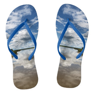 Summer landscape: clouds reflection in water flip flops