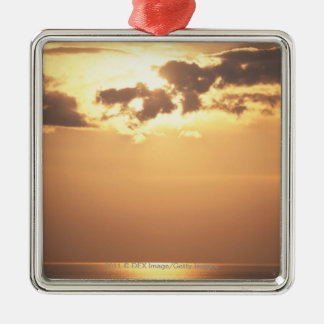 Sun goes down on the ocean christmas ornament