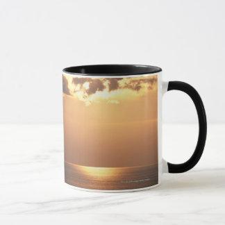 Sun goes down on the ocean mug