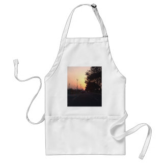 Sun on the road at sunset apron